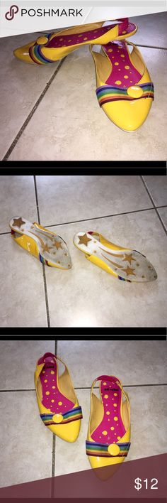 648a9fb21228eb Cute little yellow flats Little yellow flats with rainbow ribbon across  front and large button decoration. Poshmark