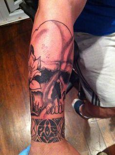Skull tattoo arm