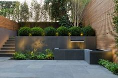 peek inside Britain's most beautiful gardens College Crescent by John Davies uses slate, bamboo and box to create a contemporary look.College Crescent by John Davies uses slate, bamboo and box to create a contemporary look. Modern Backyard, Modern Landscaping, Backyard Patio, Backyard Landscaping, Landscaping Ideas, Romantic Backyard, Sloped Backyard, Landscaping Company, Modern Landscape Design