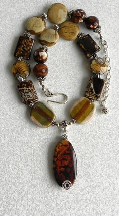 Aspen Handmade Beaded Kazuri Bead Necklace Leopard Fire Agate Picture Jasper Fall Colors. $40.00, via Etsy.