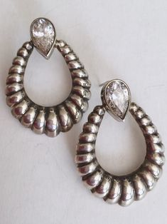 Vintage sterling silver earrings, scallop design hoops with rock crystal teardrops are so pretty. Crystal is bright a sparkling and the silver aged just enough to set off the teardrops.