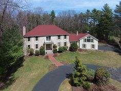 Stately center entrance colonial sited on nearly 2 private acres well back off historic Strawberry Hill Road The impressive 2 story marble foyer with bridal staircase sets the tone for this expansive property. French doors lead to a study whandsome rich wood across from the formal living room with 9 ceilings and fireplace. A bright dining room wgorgeous bay windows flows into the large renovated chefs kitchen wcenter island walk-in pantry and breakfast area. The much-loved screened porch…