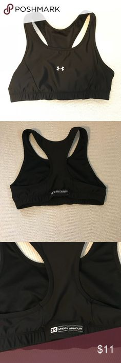 """Black Under Armour Sports Bra Black Under Armour sports bra in good condition. Light wear marks on the back side, above the Under Armour tag (Pictured above). Can fit bra size ranging from 34C to 34D comfortably. Item measures 12"""" across flat. Under Armour Tops"""