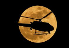 Helicopter across the big moon!