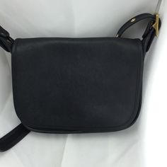 Authentic Coach Crossbody Bag! This bag is in very good to excellent pre-owned condition. It is black in color and has some very wear.  See pictures.  Inside bag is clean. The strap can be lengthened or shortened. Coach Bags Crossbody Bags