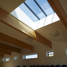 Castlefields, John McCall Architects. Timber beams and roof light.