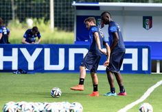 Claudio Marchisio and Mario Balotelli of Italy during a training...