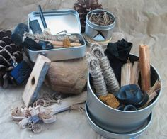 I like the display of this fire starter kit. It includes tins, steel striker and flint, budling twine, charcloth, and various tinder.