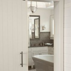 beach style bathroom by Shelter Interiors llc