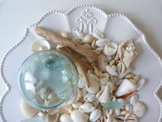 I kept a plate out on our breakfast room table with shells, and other findings from the beach when I lived with my (now ex) husband and our kids.