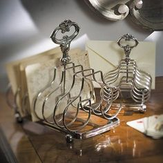 Toast-holder repurposed to hold snail-mail...adds whimsy to any space...ahhh details