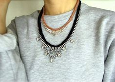 Necklaces over a sweatshirt.
