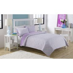 The purple floral print of this quilt set is overlayed with an aqua medallion print to give your tween's room the perfect blend of sophisticated style and colorful fun. This Dena quilt set will look just right on your twin or full size bed.