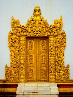 Ornate door in Mandalay, Myanmar. Doors of Southeast Asia.