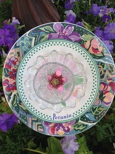 Made this one for another neighbors yard and placed in a garden of petunias. This one in lavender and pink with a cute Petunia plate. Their house was also on the Galveston Historical Foundation Home Tour. MiMi's Plate Flowers