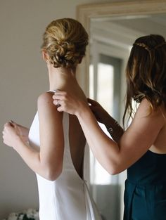 Maid of honour helping her sister prepare for her Wedding ceremony with a stunning backless dress and swept back hair style. Still from Wedding Film by The Honest Jones. Wedding Film, Wedding Ceremony, Swept Back Hair, Backless Wedding, Maid Of Honor, Films, Weddings, Wedding Dresses, Hair Styles