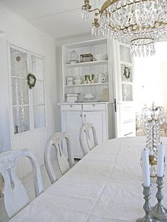 White dining room...farmhouse, chandelier, elegant, cabinet, ironstone, pretty, shabby chic