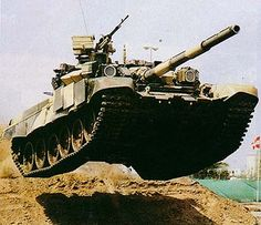 Google Image Result for http://media.defenseindustrydaily.com/images/LAND_T-90_Catching_Air_lg.jpg