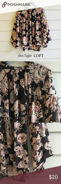 Sheer & Flowy paisley top Gorgeous blouse from Ann Taylor LOFT is a loose fitting so could fit Small or Med. Light & breezy with asymmetrical bell-like sleeves. This top can be worn with cute solid shorts or a skirt for work. Light enough for the season.  The pictures don't do it justice! LOFT Tops Blouses