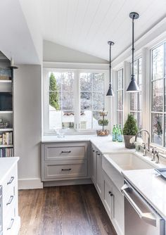 Gray Kitchen with Windows, no upper cabinetry | Christopher Architects