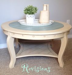 A cocktail table refinished with old ochre and duck egg blue. Clear and dark wax used for an aged finish