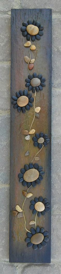 FREE SHIPPING  This piece will be made to order:  Beautifully created from all natural materials - The flowers petals are black little pebbles, and the stems are twigs. The reclaimed wood is painted in acrylics, and sprayed lightly with sealant to give it a shiny appearance. The back/reverse side is also painted. Approx measurements are 30 inches long and 3 inches wide, ready to hang.  I always love special requests, and this type of work is wonderful for any occassion or gift idea. If y...
