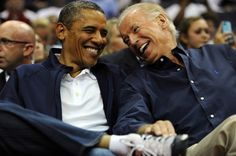 President Barack Obama and Vice President Joe Biden share a laugh as the US Senior Men's National Team and Brazil play during a pre-Olympic exhibition basketball game at the Verizon Center on July 16, 2012 in Washington, DC.