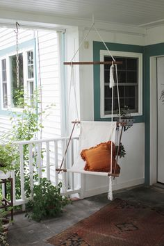 Designed to be hung from the ceiling of a covered patio, this DIY hanging lounge chair from Caitlin of The Merrythought is fashioned simply from oak dowels and a canvas drop cloth. Homemade Outdoor Furniture, Backyard Furniture, Furniture Projects, Diy Furniture, Diy Projects, Project Ideas, Indoor Swing, Porch Swing, Diy Swing