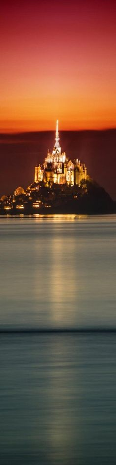 """An amazing castle in France where the sea rolls in at night to form an island - from the Exhibition: """"Cropped for Pinterest"""" - photo from #treyratcliff Trey Ratcliff at www.StuckInCustoms.com"""