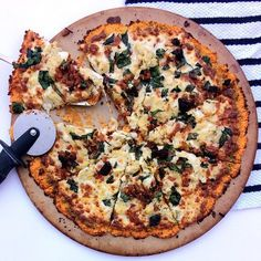 SWEET POTATO PIZZA CRUST Using a food processor- pulverize 2 large sweet potatoes (should yield 3 c mashed sweet potato)  Mix in 1/2 tsp minced garlic & 1/2 tsp kosher salt  Mix in 2 egg whites  Spread mixture onto a pizza round in shape of round pizza- I love this pizza stone from pampered chef!  Bake at 425 for 20 min