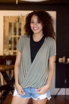 Lightweight short sleeve tee, in army green, featuring a surplice front detailing // $58 #shoplocal #freepeople #freepeopleboutique #antiquegarden