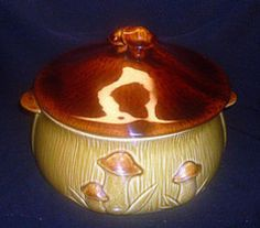 Vintage Mushrooms Covered Serving Dish Bowl Casserole Soup Tureen  Brown Glazed Finish with tiger maple accent in glaze.  Material: Ceramic  Unmarked, Maker unknown  Size 2.25 quarts    Product Description  Beautifully made of ceramic pottery in a glossy light and dark colored finish that resembles tiger maple on the lid.  This bowl is suitable as a serving dish for your main dishes or soups.