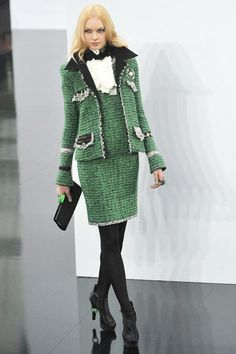 Must have Sage Green CHANEL suit and black suède boots and black quilted Chanel clutch bag