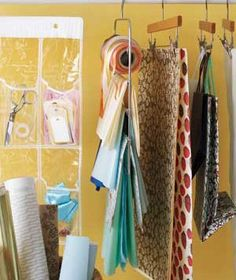 Keep individual sheets of wrapping paper crease-free by clipping the to a pants or skirt hanger.  Do the same with gift bags, or loop their handles over the hook.  A shoe organizer is a great place to stash scissors, tape, gift tags and other decorating supplies.