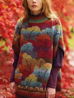 This is a colourwork tabard from the inimitable Kaffe Fassett, very much reminiscent of some of his earlier work. The whole body of the garment is charted, worked using intarsia in a pattern of shaded leaves.