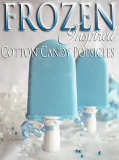 "Disney Frozen Inspired Cotton Candy Popsicles made with a few simple ingredients including milk, cream, vanilla pudding, blue cotton candy, blue food dye and cotton candy extract flavoring are a fun ""icy cool"" treat to serve at a Frozen themed party. These would make cute treats for a Cinderella themed party too!"