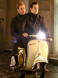 Full speed ahead! Costars Henry Cavill and Armie Hammer keep their eyes on the road while filming their new movie, The Man from U.N.C.L.E., in Rome. http://www.people.com/people/gallery/0,,20741881,00.html#30031637