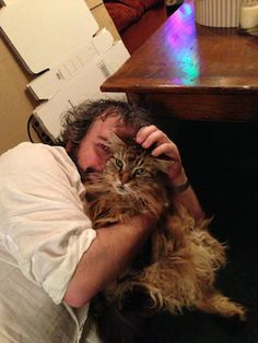 """""""Peter Jackson Celebrates the End of 'The Hobbit' Filming With His Cat, Mr. Smudge"""" -- Totally cute photo that Jackson posted on his Facebook page (https://www.facebook.com/PeterJacksonNZ) on July 26, 2013, celebrating the end of filming a 15-year project."""