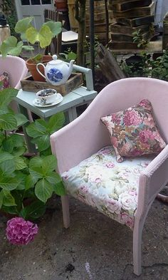 Vintage Lloyd Loom chairs painted in Annie Sloan pink and re-covered in Sanderson style fabric.