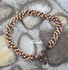 Spiral bracelet with farfalle (peanut) beads. Designed and made by HTünde (Beaddict).