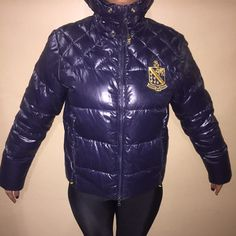 One of a kind Rugby Ralph Lauren puffer coat Only worn once LIKE new. Very warm Navy blue rugby coat no longer sold . Has Rugby logo with yellow and navy lining. Ralph Lauren Jackets & Coats Puffers