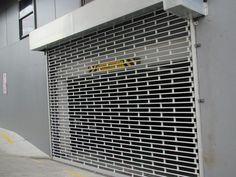 Roller grilles offer excellent security when closed but display can still be viewed. When the is open, shop and shop display can be on full display. Easy to operate. Retail Security, Window Security, Security Gates, Roller Doors, Roller Shutters, Rolling Shutter, Window Bars, Window Grill Design, Industrial Door