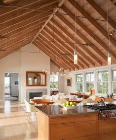 Wooden Kitchen Island With Storage And Dining Space Decorated By Lovely Hanging Lamps Along With Open Dining And Living Area Under The Fabulous Wooden Ceiling Eclectic Home with High Ceiling and Open Plan Interior Home design