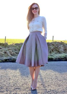 full skirt, cropped cardigan and high heels