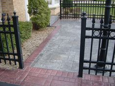 Stamped concrete patio with bluestone, ashlar slate pattern and red brick border.