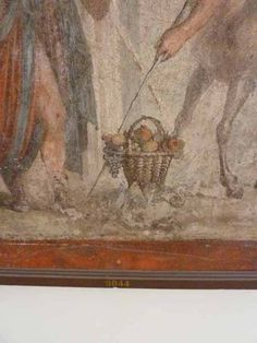 A basket of fruit brought as a gift. VII.2.16 Pompeii. Room 17, detail from painting on west wall of exedra. House of Gavius Rufus or Casa di Teseo or House of the Seven Skeletons. 1st c. CE.