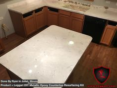 After pic of another customer installing our #DIY #metallic #epoxy #countertop #resurfacing #kit it was applied right over there existing #Formica #countertops #kitchendesign #kitchencounter #countertopepoxy #countertopresurfacing #countertopcoatings #countertoprefinishing