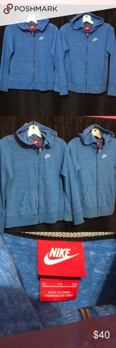 Pair of Nike full zip hoodies Matching girls xl Nike hoodies. Both worn gently, other then normal signs of wear there are no flaws of any kind, no pilling. Both girls xl, sometimes I dress my girls in matching outfits. These hoodies are heathered blue. Mainly made from organic cotton. Fabric is thin and VERY soft. Lightweight material. Perfect for wearing at school, about the same heavynsss of a long sleeve cotton tee. This price buys you BOTH hoodies, I can sell separately upon request…