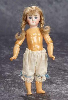 "8"" Petite German bisque closed mouth child, rare model 800 with fully-jointed body. $400/600"