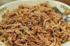 Southern Style Pulled Pork BBQ- Slow Cooker Recipe.  That's right, IN A CROCK POT!  I left the layer of fat on top while cooking, then removed it from the tenderloin when finished.  There was enough fat melted into the sauce to let the meat remain moist, but not greasy.  This taste JUST LIKE pig pickin bbq or Eastern NC restaurant style bbq.  I can't remember the last time I ate pork, but I had to try this for myself.